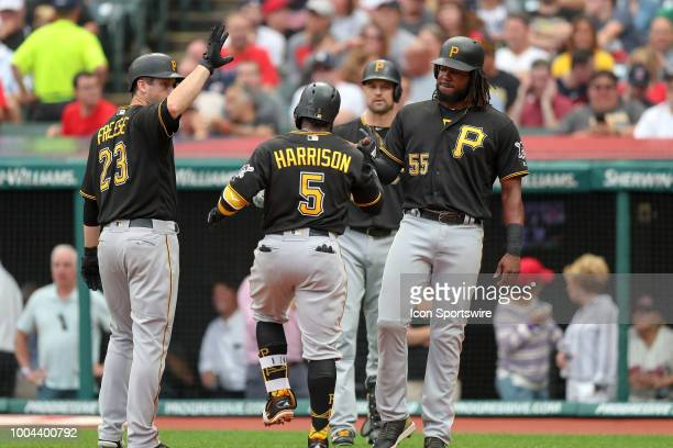 Pittsburgh Pirates second baseman Josh Harrison is greeted at home plate by Pittsburgh Pirates infielder David Freese and Pittsburgh Pirates first...