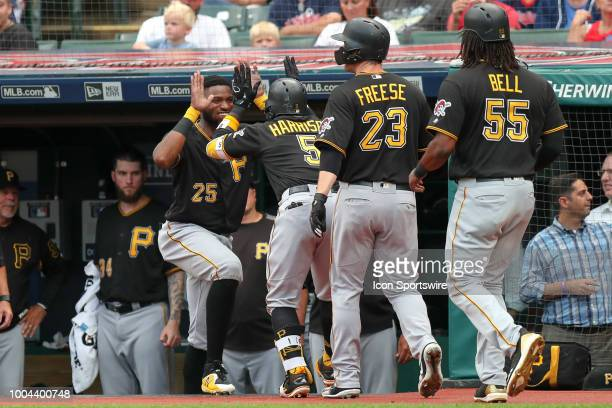 Pittsburgh Pirates second baseman Josh Harrison is greeted by Pittsburgh Pirates outfielder Gregory Polanco after he Pittsburgh Pirates infielder...