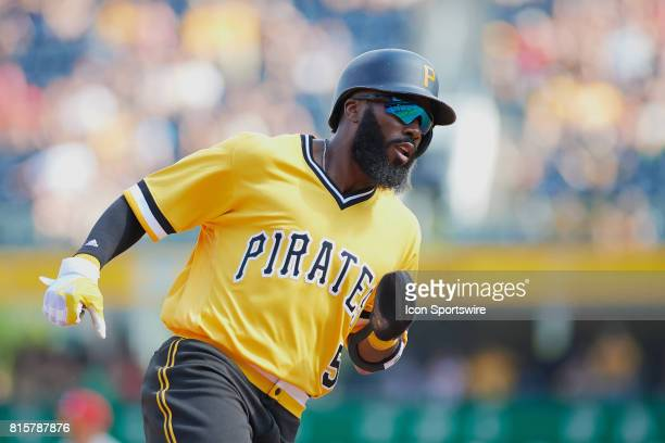 Pittsburgh Pirates second baseman Josh Harrison rounds third base and ties the game 33 during an MLB game between the Pittsburgh Pirates and the St...