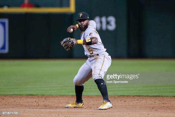 Pittsburgh Pirates second baseman Josh Harrison throws the ball to first base during the MLB baseball game between the Pittsburgh Pirates and the...