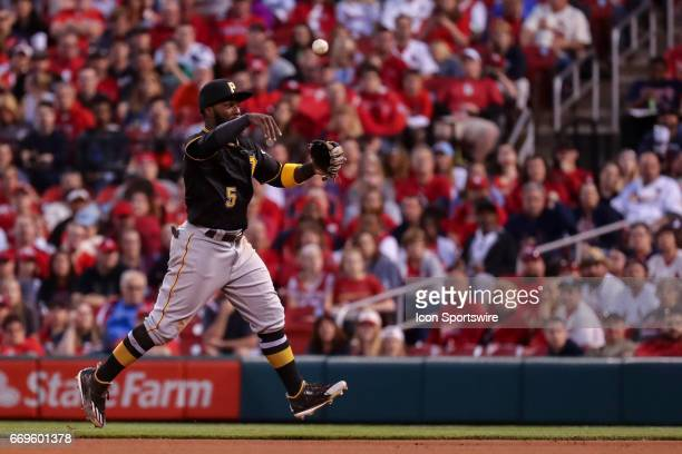 Pittsburgh Pirates Second baseman Josh Harrison throws to first base for an out during the sixth inning of a baseball game on April 17 at Busch...