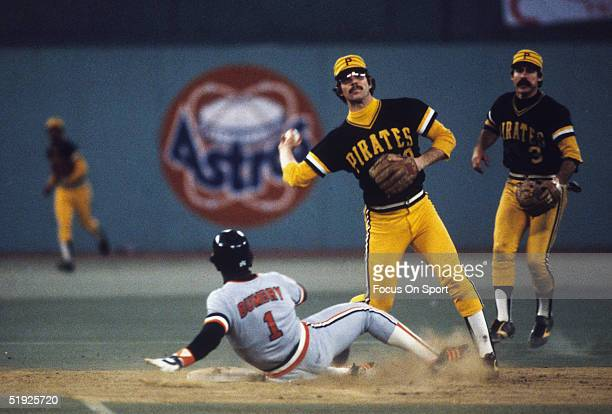 Pittsburgh Pirates' second baseman Tim Foli throws to first for a double play after forcing out Baltimore Orioles' Al Bumbry as he slides into base...