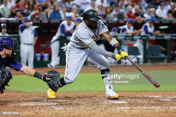 Pittsburgh Pirates Third base Josh Harrison reaches for a low pitch during the MLB baseball game between the Pittsburgh Pirates and the Arizona...