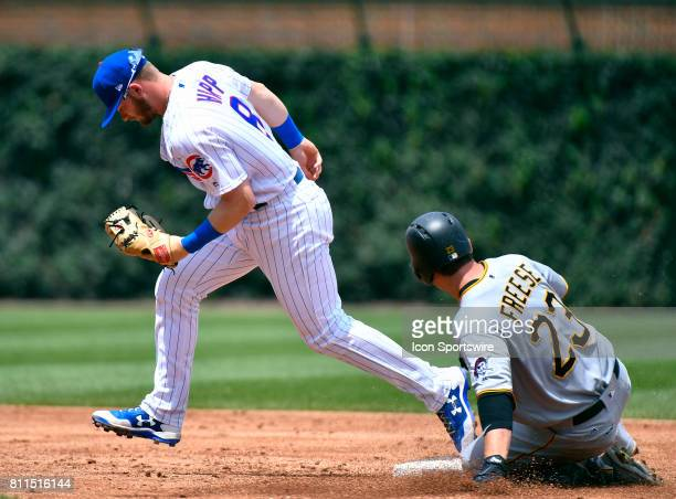 Pittsburgh Pirates third baseman David Freese is tagged out at second base by Chicago Cubs second baseman Ian Happ during the game between the...