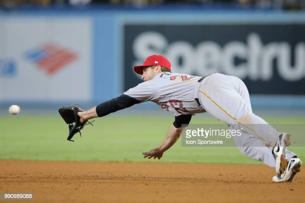 Pittsburgh Pirates third baseman David Freese makes a diving catch to catch the line drive in the game between the Pittsburg Pirates and the Los...