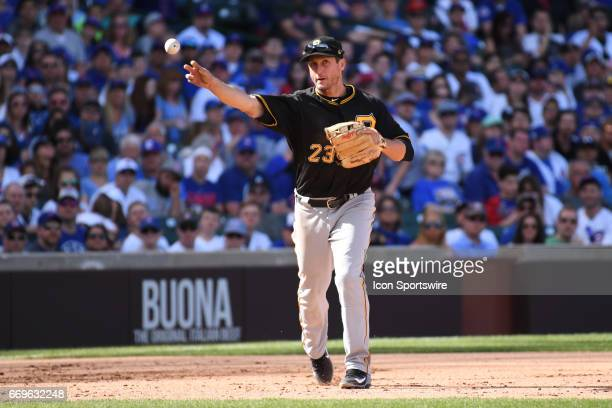 Pittsburgh Pirates third baseman David Freese throws to first base during a game between the Pittsburgh Pirates and the Chicago Cubs on April 16 at...