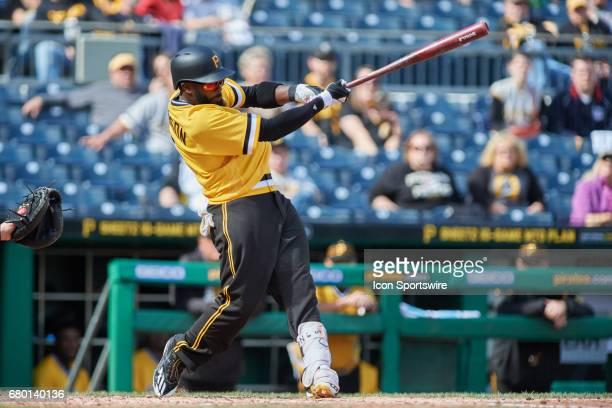 Pittsburgh Pirates third baseman Josh Harrison singles in the ninth inning during an MLB game between the Pittsburgh Pirates and the Milwaukee...