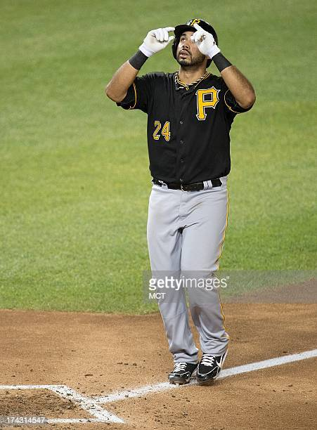 Pittsburgh Pirates third baseman Pedro Alvarez points to the heavens at home plate after hitting a home run against the Washington Nationals during...