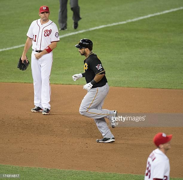 Pittsburgh Pirates third baseman Pedro Alvarez rounds the bases between Washington Nationals third baseman Ryan Zimmerman and starting pitcher Taylor...