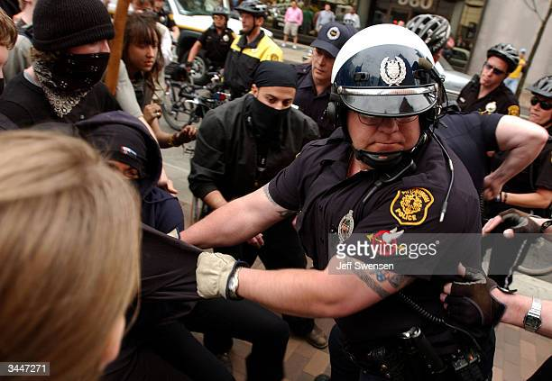 Pittsburgh police officers arrest protestors outside the David L Lawrence Convention Center April 19 2004 in Pittsburgh Pennsylvania US President...