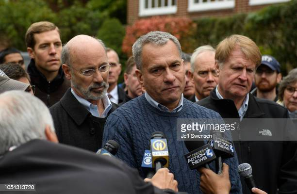 Pittsburgh Public Safety Director Wendell Hissrich flanked by Governor Tom Wolf and Allegheny County Executive Rich Fitzgerald describes the gravity...