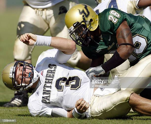 Pittsburgh quarterback Tyler Palko is sacked by South Florida's Tyller Roberts during game at Raymond James Stadium in Tampa Florida on November 4...
