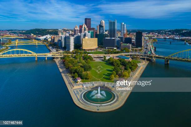 pittsburgh skyline aerial with fountain, two rivers and bridges - pennsylvania stock pictures, royalty-free photos & images