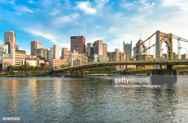 "pittsburgh skyline as seen from north shore with ""one ppg place"" building and ""rachel carson bridge"" on allegheny river waterfront in pennsylvania, usa - pittsburgh fotografías e imágenes de stock"