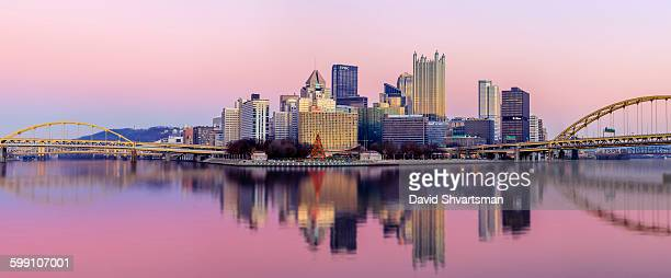 Pittsburgh skyline at sunset from the river bank