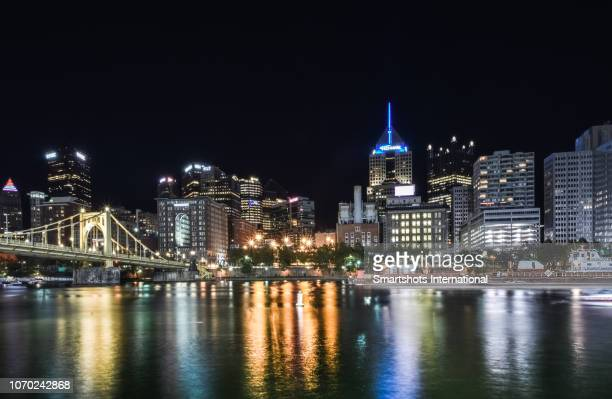 Pittsburgh skyline illuminated at night as seen from the North Allegheny riverside in Pennsylvania, USA