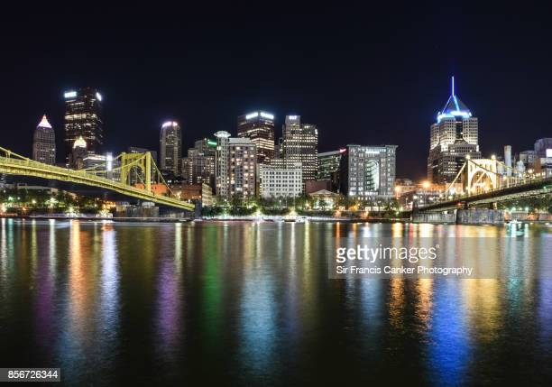 Pittsburgh skyline illuminated with Roberto Clemente bridge and Andy Warhol bridge spanning the Allegheny river at night in Pennsylvania, USA
