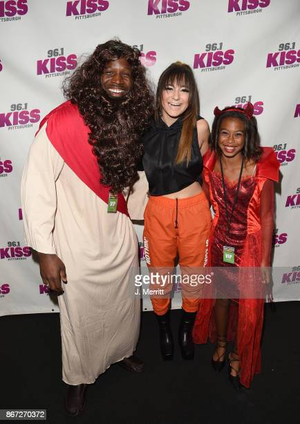 Pittsburgh Steeler Arthur MOats and recording artist Daya pose backstage during the Kiss 961 Halloween Party 2017 at Stage AE on October 27 2017 in...
