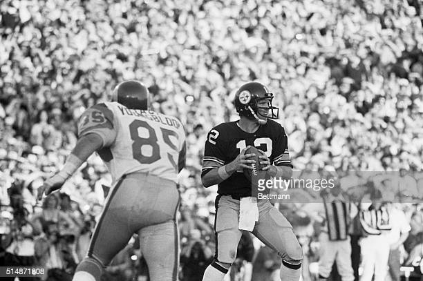 Pittsburgh Steeler quarterback Terry Bradshaw looks downfield as he prepares to pass in a Superbowl game against the Los Angeles Rams