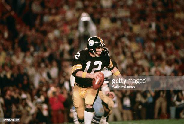 Pittsburgh Steeler quarterback Terry Bradshaw sprints out to pass against the Dallas Cowboys in the 1978 Super Bowl at Miami's Orange Bowl