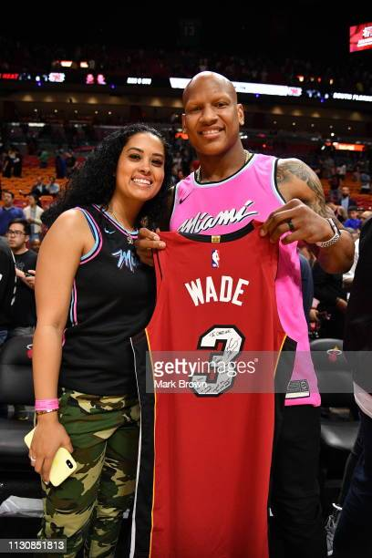 Pittsburgh Steeler Ryan Shazier and his fiancé Michelle Rodriguez pose with a Dwyane Wade of the Miami Heat jersey after the game between the Miami...