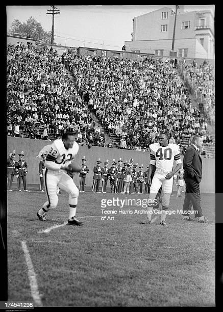 Pittsburgh Steelers and Cleveland Browns football game including Cleveland player Jim Brown warming up before game in Pitt Stadium Oakland Pittsburgh...