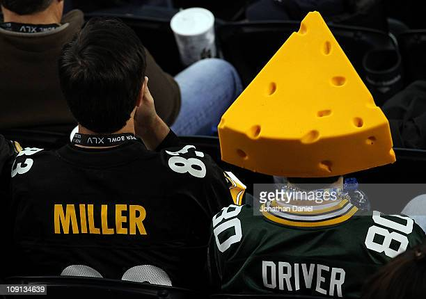 Pittsburgh Steelers and Green Bay Packers fan sit next to each other during Super Bowl XLV at Cowboys Stadium on February 6 2011 in Arlington Texas