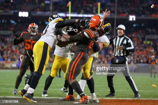 Pittsburgh Steelers center Maurkice Pouncey punches Cleveland Browns defensive end Myles Garrett in the helmet after Garrett hit Pittsburgh Steelers...