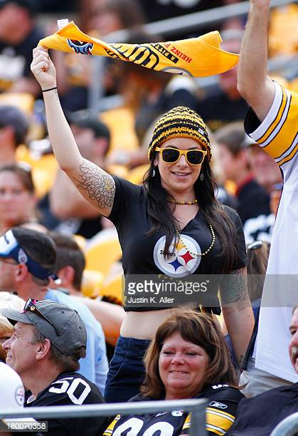 Pittsburgh Steelers cheer against the Tennessee Titans during the game on September 8 2013 at Heinz Field in Pittsburgh Pennsylvania The Titans...