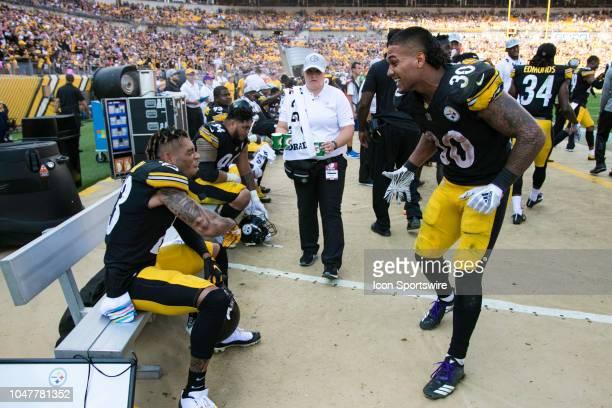 Pittsburgh Steelers cornerback Joe Haden celebrates with Pittsburgh Steelers running back James Conner during the NFL football game between the...