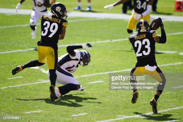 Pittsburgh Steelers cornerback Joe Haden intercepts a pass intended for Denver Broncos wide receiver Courtland Sutton in the second quarter at Heinz...
