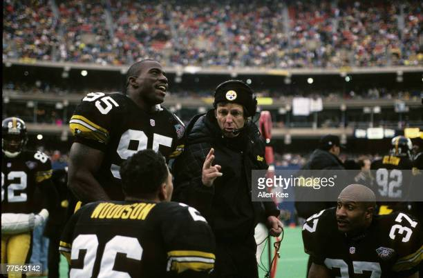 Pittsburgh Steelers defensive coordinator Dick Le Beau talks to linebacker Greg Lloyd and safeties Rod Woodson and Carnell Lake during the AFC...