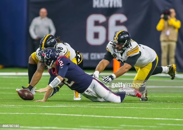 Pittsburgh Steelers defensive end Cameron Heyward reaches for Houston Texans quarterback TJ Yates after he fumbled the ball during the game between...