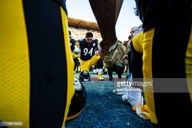 Pittsburgh Steelers defensive end Tyson Alualu and other players pray together during the NFL football game between the Indianapolis Colts and the...