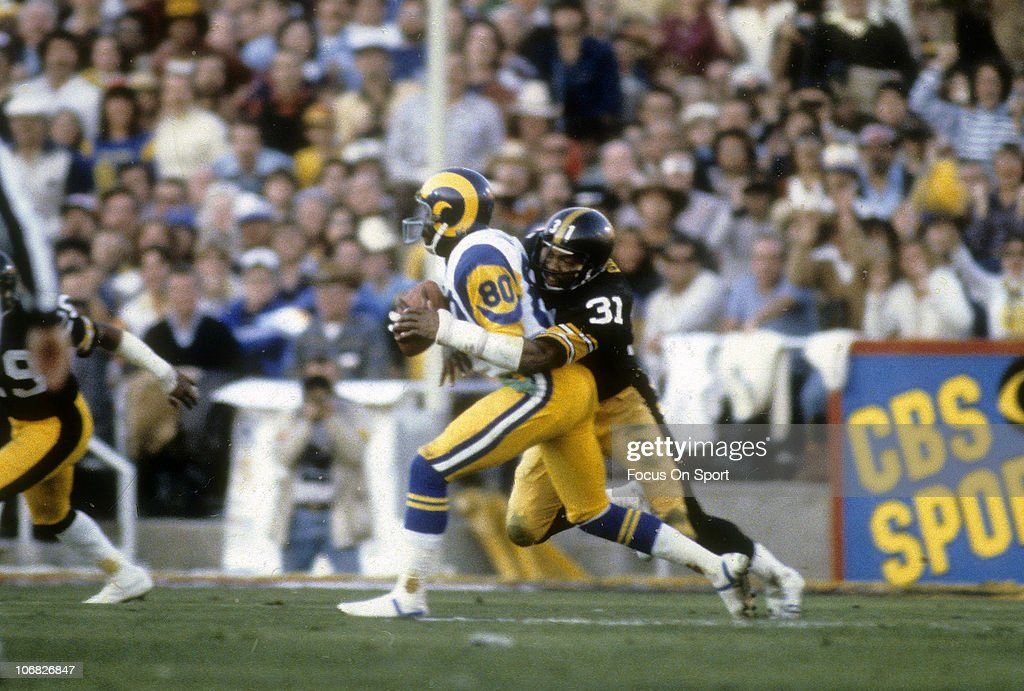 Pittsburgh Steelers Donnie Shell #31 of the Pittsburgh Steelers tackles Billy Waddy #80 of the Los Angeles Rams during Super Bowl XIV at the Rose Bowl January 20, 1980 in Pasadena, California. The Steelers won the Super Bowl 31 -19.