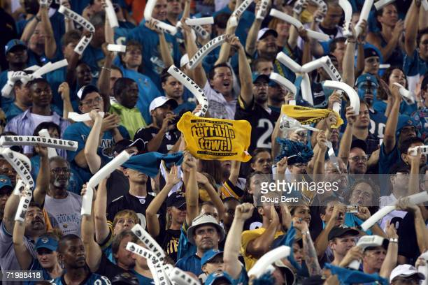 Pittsburgh Steelers fan holds a 'Terrible Towel' even though he is surrounded by Jacksonville Jaguars fans during the game at Alltel Stadium on...