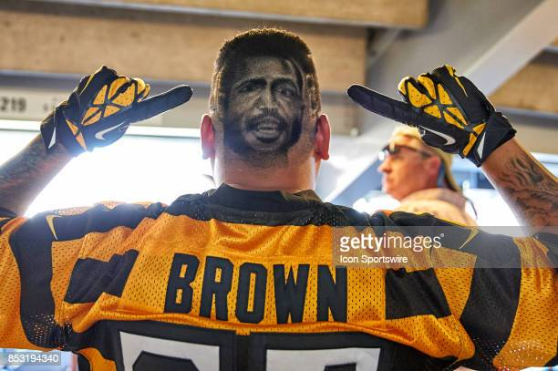 Pittsburgh Steelers fan shows off his haircut designed with Pittsburgh Steelers wide receiver Antonio Brown face on hi head during an NFL football...