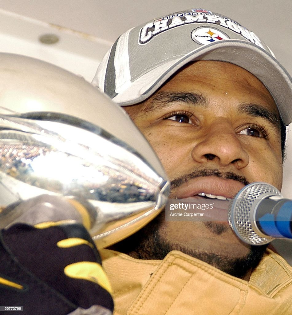 Pittsburgh Steelers fans are reflected in the Vince Lombardi Trophy as Jerome Bettis speaks to the crowd following the parade in downtown celebrating the win at Super Bowl XL on February 7, 2006 Pittsburgh, Pennsylvania.