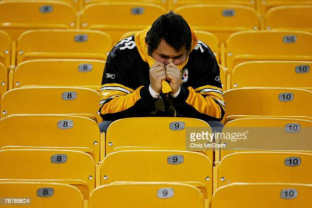 Pittsburgh Steelers fans sits in the stands after the Steelers lost to the Jacksonville Jaguars in the AFC Wild Card game on January 5 2008 at Heinz...