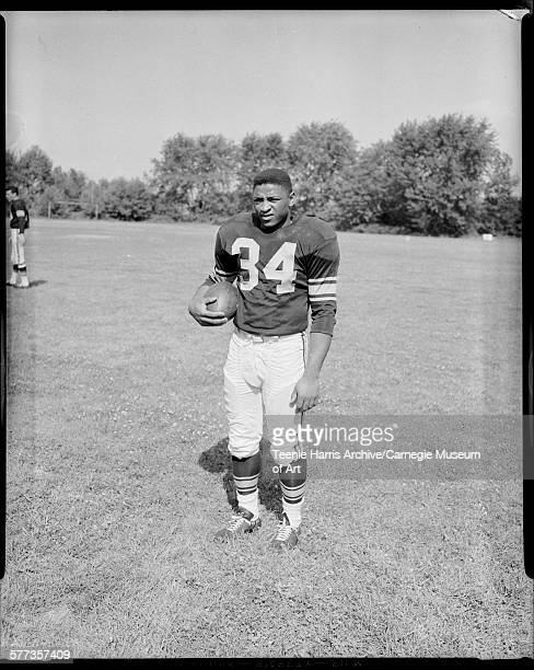 Pittsburgh Steelers football player no 34 Charlie Scales holding ball on athletic field at Slippery Rock State Teachers College Slippery Rock...