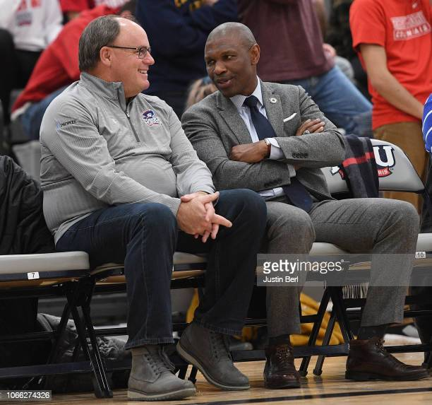 Pittsburgh Steelers General Manager Kevin Colbert talks with Robert Morris University President Doctor Christopher Howard during the second half in...