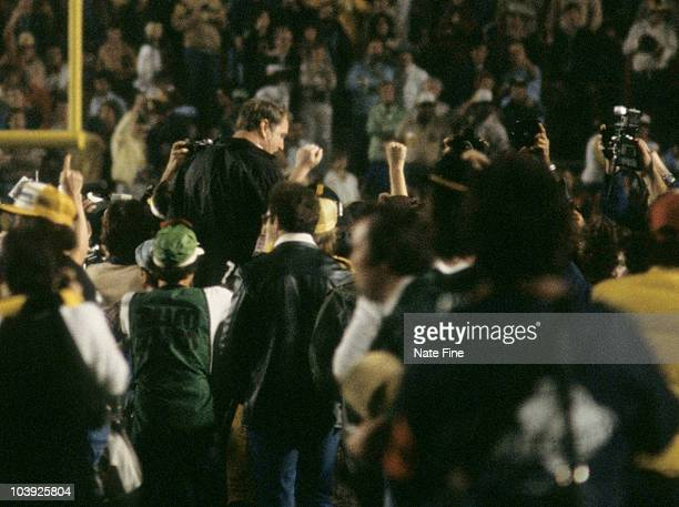 Pittsburgh Steelers Hall of Fame head coach Chuck Noll is carried off the field by his players after a 3531 win over the Dallas Cowboys in Super Bowl...