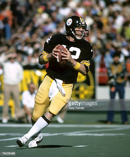 Pittsburgh Steelers Hall of Fame quarterback Terry Bradshaw drops back to pass during a 24-17 loss to the Houston Oilers on October 23 at Three...