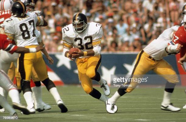 Pittsburgh Steelers Hall of Fame running back Franco Harris carries the ball during a preseason game at Schaefer Stadium in Foxboro Massachusetts in...