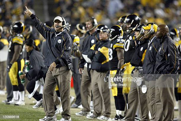 Pittsburgh Steelers Head Coach Bill Cowher disputes time remaning on the game clock late in the 4th quarter of play during action against the...