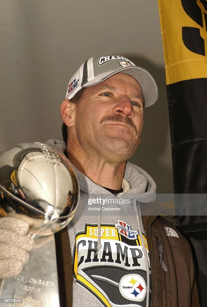 Pittsburgh Steelers head coach Bill Cowher pauses before speaking to the crowd gathered at the end of victory parade celebrating winning Super Bowl XL February 7, 2006 in downtown Pittsburgh Pennsylvania.