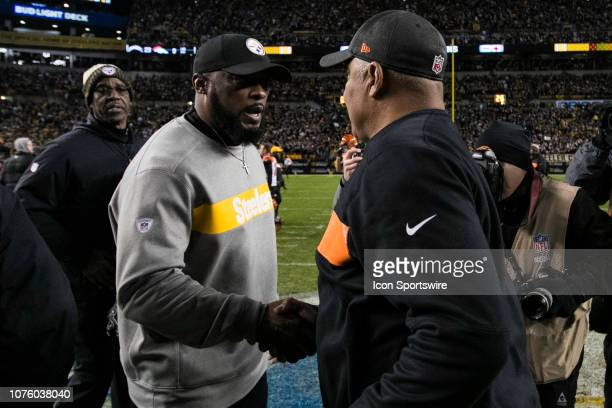 Pittsburgh Steelers head coach Mike Tomlin and Cincinnati Bengals head coach Marvin Lewis shake hands after the ball during the NFL football game...