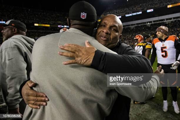 Pittsburgh Steelers head coach Mike Tomlin gives Cincinnati coach Hue Jackson a hug during the NFL football game between the Cincinnati Bengals and...