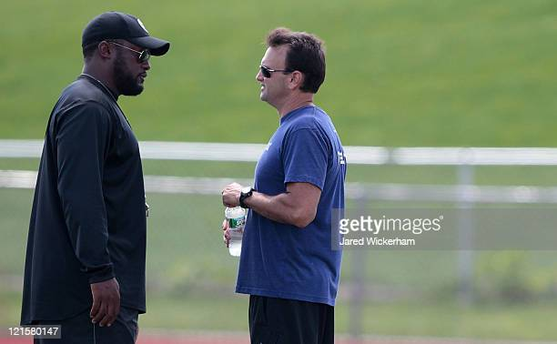 Pittsburgh Steelers head coach Mike Tomlin talks with agent Drew Rosenhaus following Terrell Pryor's pro day at a practice facility on August 20,...