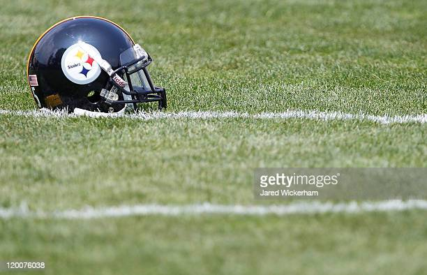 Pittsburgh Steelers helmet sits on the practice field during training camp on July 29, 2011 at St Vincent College in Latrobe, Pennsylvania.